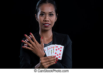 The female banker clamp red dices between her fingers and...