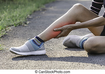 The female clings to a bad leg. The pain in her leg. Health and painful concept.