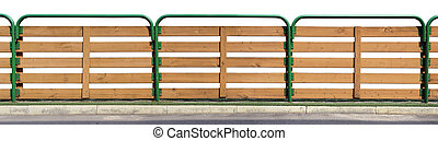 The fence of a small urban school stadium isolated
