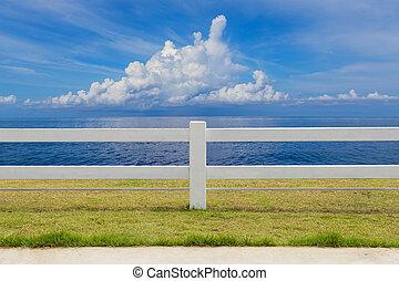 The fence on grassland and cloud blue sky