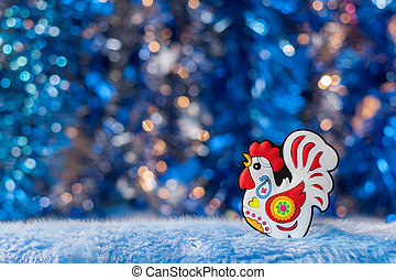 The figure of symbol 2017 cock on a beautiful background bokeh.