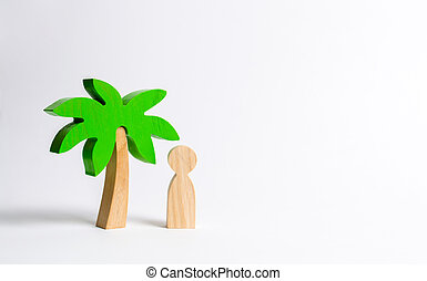 The figure of the person costs under a wooden palm tree on a white background. Vacation or trip. Stuck on a desert island. Personal space and moral rest. Harmony, balance in life, psychological health
