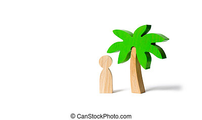 The figure of the person costs under a wooden palm treeon an isolated background. Vacation or trip. Stuck on a desert island. Personal space and moral rest. balance in life, psychological health