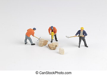 Figurine of construction worker at construction site