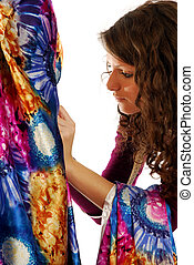 The final touches to a dress
