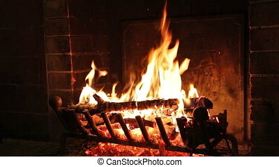 The fire is burning in the fireplace - A cozy view of the...