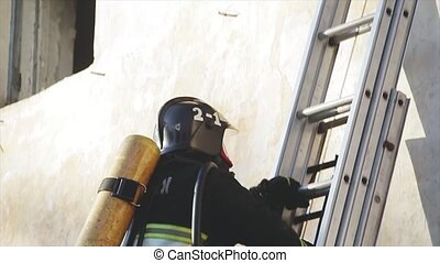 the firefighter climbs the stairs