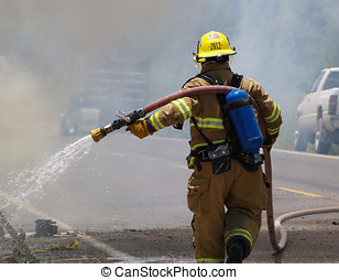 The Firefighter - An Arizona firefighter repositioning his...