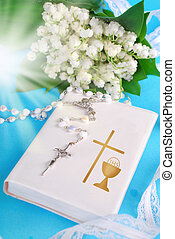 the first holy communion - white prayer book,rosary and lily...