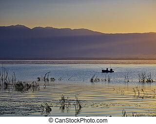 The first rays of the sun and fishermen