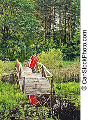 The fisher in a red raincoat