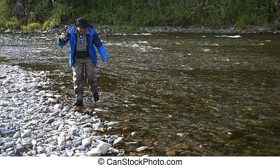 The fisherman - Fishing on the mountain river with fast ...