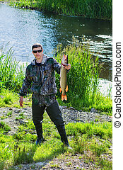 The fisherman with the caught pike