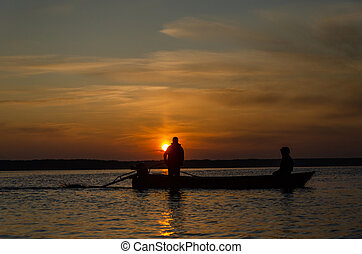 The fishermen and boat silhouette
