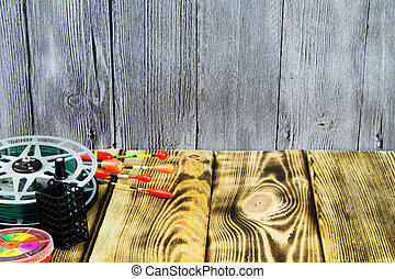 The fishing accsessories on the wooden table - The fishing...