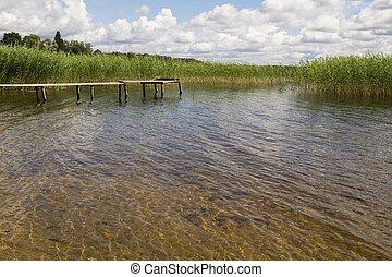 The fishing bridge on lake.
