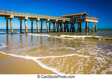 The fishing pier and Atlantic Ocean at Tybee Island,...