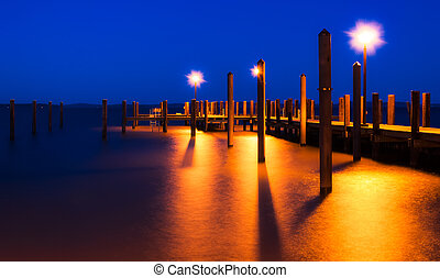 The fishing pier in Havre de Grace, Maryland at night. - The...