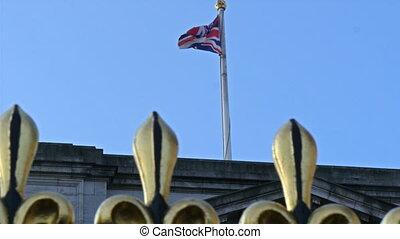 The flag of England on a pole of the Buckingham Palace