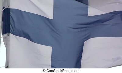 The flag of Finland a blue Nordic cross in Slow Motion