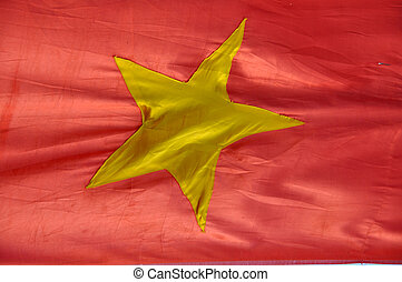 The flag of Vietnam, a yellow star
