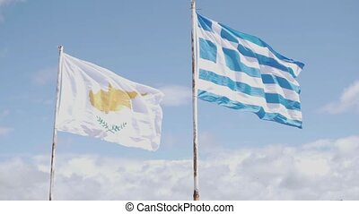 The flags of Cyprus and Greece are standing nearby