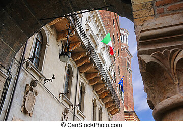 The flags of Italy and Europe in the facade of the Palazzo del C