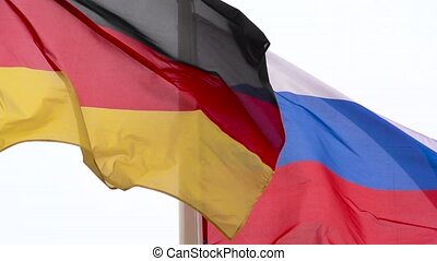 The flags of Russia and Germany.
