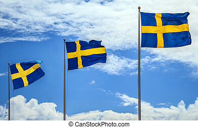The flags of Sweden.