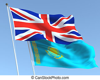 The flags of United Kingdom and Kazakhstan on the blue sky. For news, reportage, business. 3d illustration