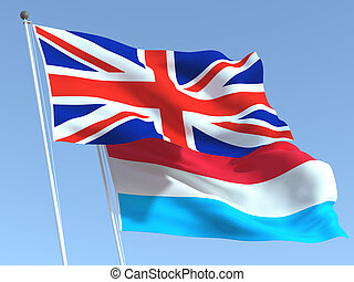 Two waving state flags of United Kingdom and Luxembourg on the blue sky. High - quality business background. 3d illustration
