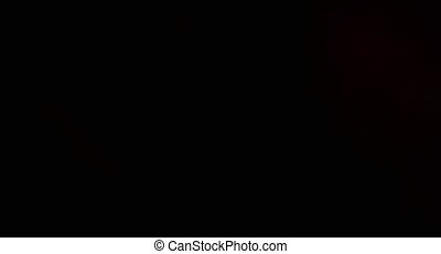 The flickering reflections of light red color on black background HD