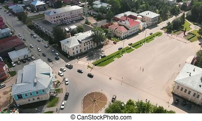 The flight of the camera over the central square of Totma, a sunny summer day and a blue sky