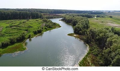 the flight of the drone over the river. View from a height