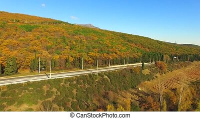 The flight of the quadrocopter over the autumn forest and...