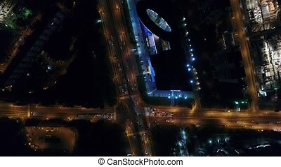 The flight over city traffic at night