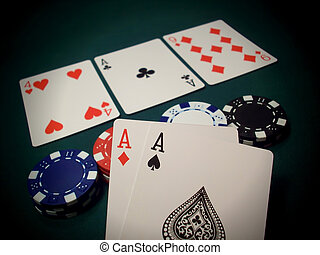 The Flop Texas Hold 'Em Cards And Chips - Three cards face...