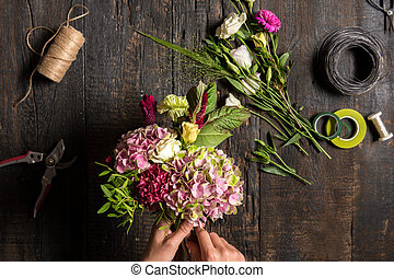 The florist desktop with working tools and ribbons - The...