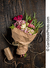 The flowers on wooden background
