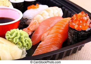 The focus of salmon caviar ikura sushi menu closeup