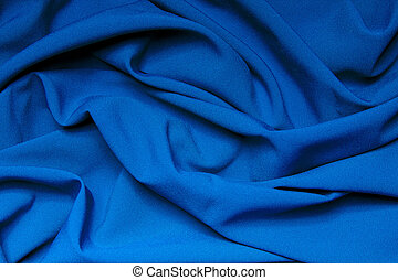 The folds of a bright blue cloth. Abstract Background