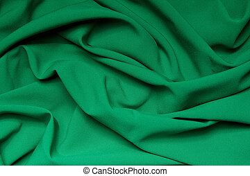 The folds of a bright green cloth. Abstract Background