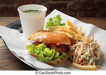 The food with soup, burger and salad on a tray