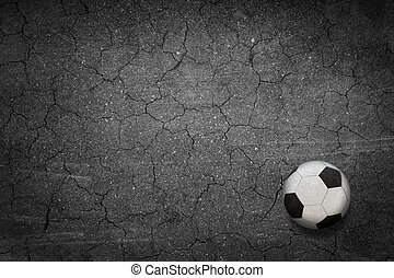 The football against a black background.