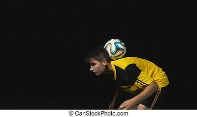 the footballer catches the ball - soccer player catches the...