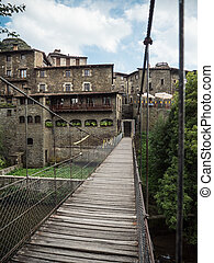 The footpath bridge in the village of Rupit i Pruit