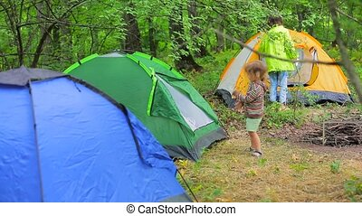 The forest is a campground. - Family hike. The forest is a...