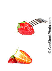 The fork pricking the strawberry