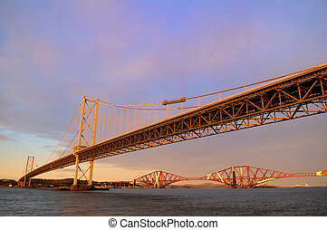 The Forth Road and Rail Bridges, bathed in evening light.