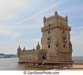 Lisbon's main attraction - the fortress of Belem. The white tower is decorated with stone laces in medieval style